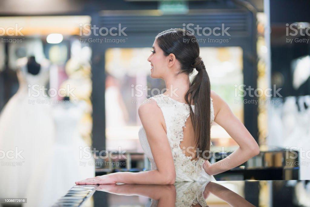 Having fun at bridal shop stock photo