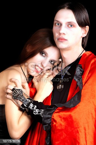 Gothic couple in Halloween costume. Gloomy vampires with Gothic clothes for Halloween party.