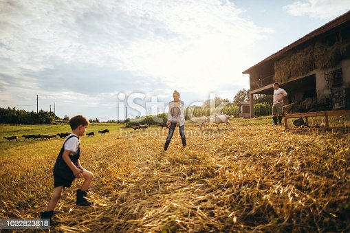 Happy family spending day at their family farm