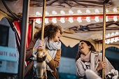 istock Having fun in amusement park 1203588104