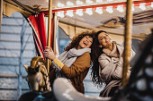 istock Having fun in amusement park 1203588221