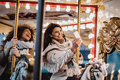 istock Having fun in amusement park 1203589289
