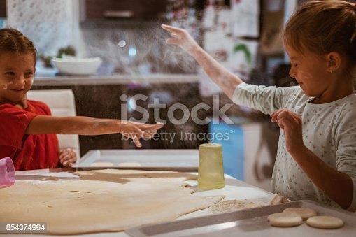 istock having fun in kitchen 854374964
