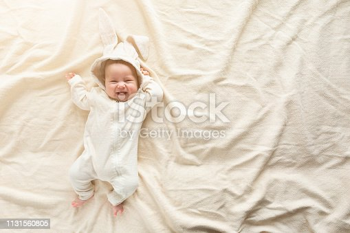 istock Having fun on Easter day. Baby boy wearing bunny costume with ears smiling. 1131560805
