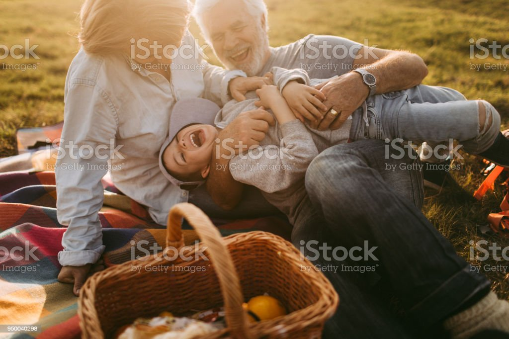 Having fun on picnic with my grandparents royalty-free stock photo. Only  from iStock 5841558a7
