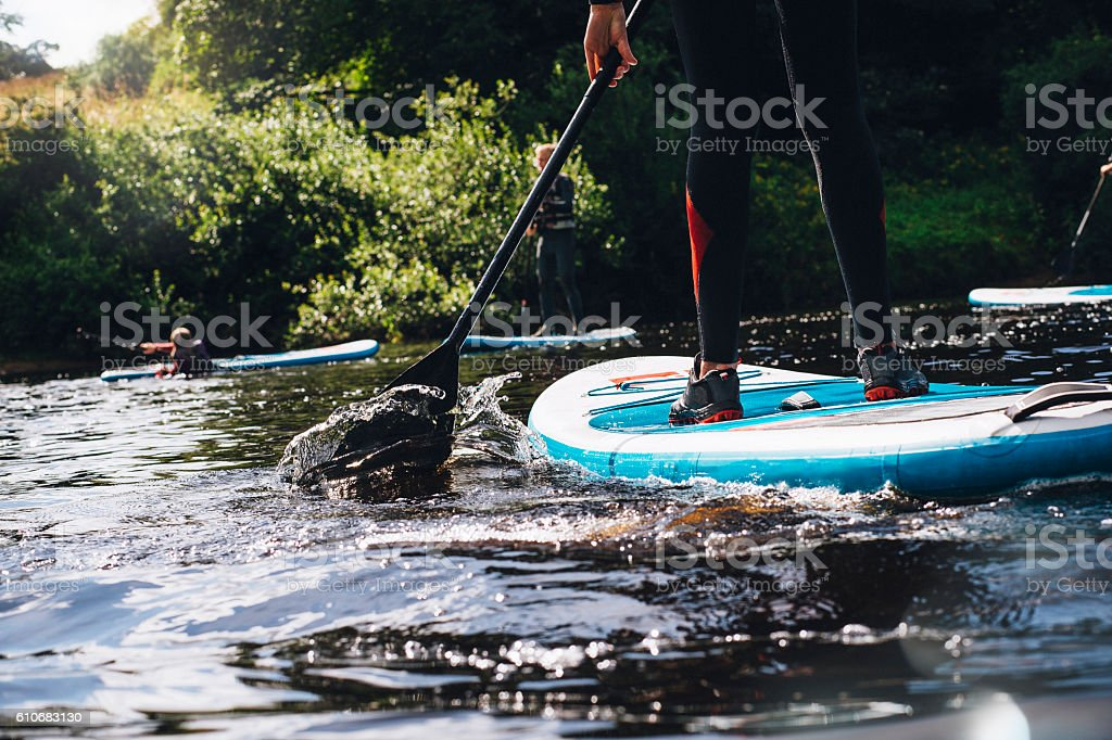 Having Fun Paddleboarding stock photo