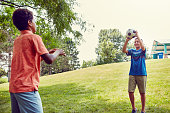 Shot of adorable young boys playing outdoors