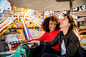 Two friends riding amusement park ride