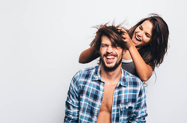 a divertir-se - puxar cabelos imagens e fotografias de stock