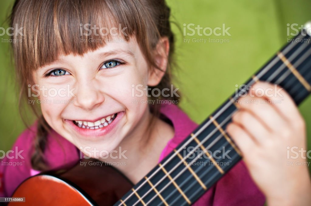 Having fun playing the guitar royalty-free stock photo