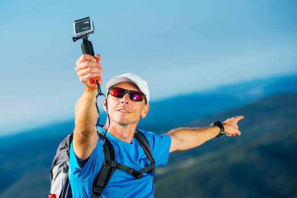 having fun taking selfie - gopro stockfoto's en -beelden