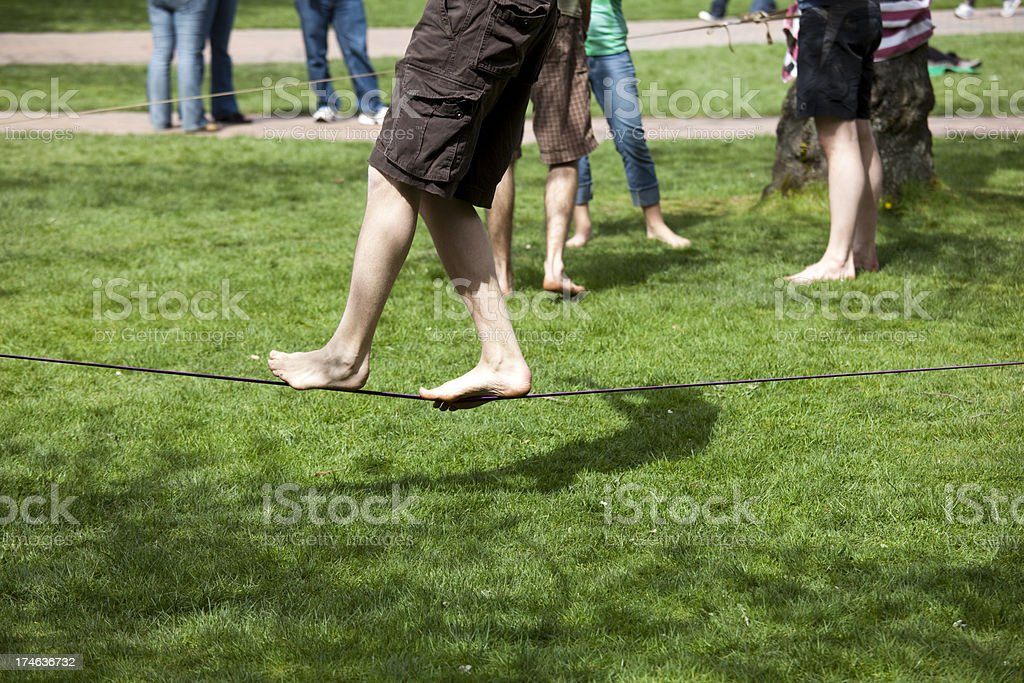 Having fun tight rope walking in the park royalty-free stock photo