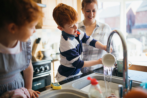 Having Fun Washing The Dishes Stock Photo - Download Image Now