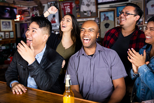 istock Having fun watching the game at the sports bar 1134336003