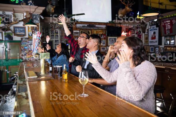 Having fun watching the game at the sports bar picture id1134336174?b=1&k=6&m=1134336174&s=612x612&h=bzqr mgp0lveexvb6fqa6zrly2c zmnysm02atfseqc=