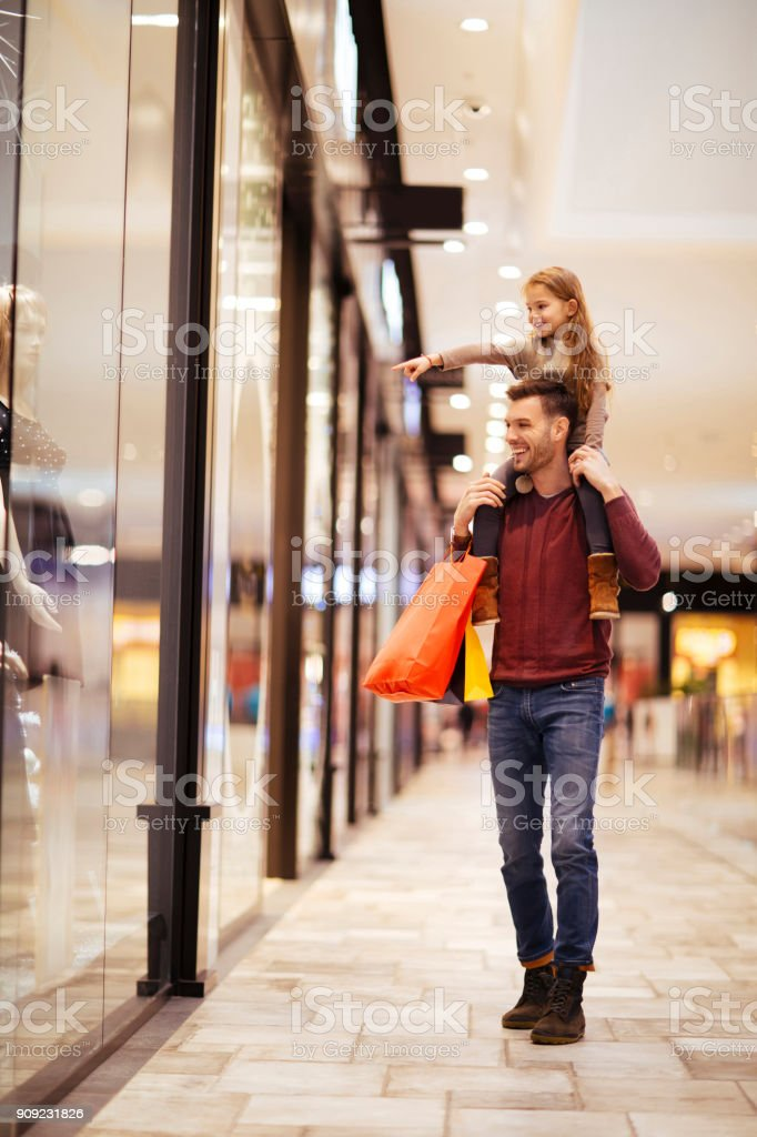 Having fun while looking Shop windows stock photo