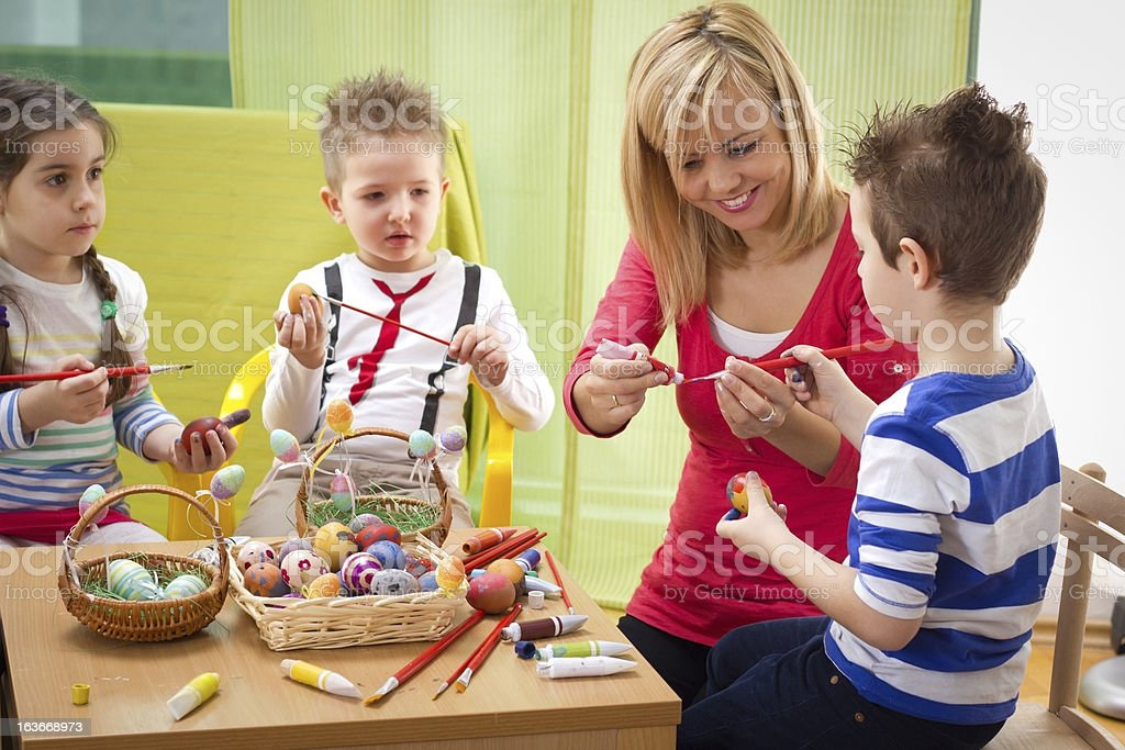Having fun while painting easter eggs royalty-free stock photo