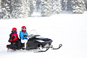Having fun with a snowmobile in the winter