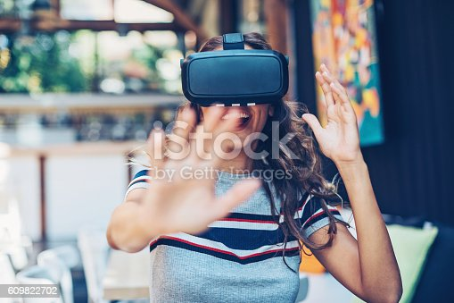 istock Having fun with a virtual reality headset 609822702