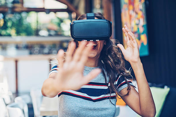 Having fun with a virtual reality headset stock photo