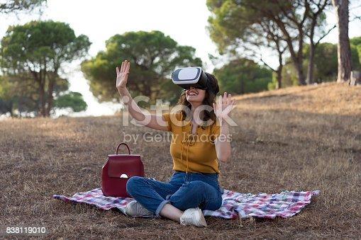 istock Having fun with a virtual reality headset 838119010