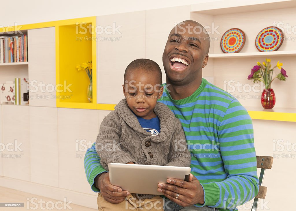 Having fun with daddy on his new tablet royalty-free stock photo