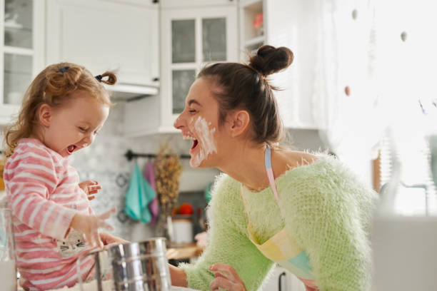 Having fun with flour in the kitchen stock photo