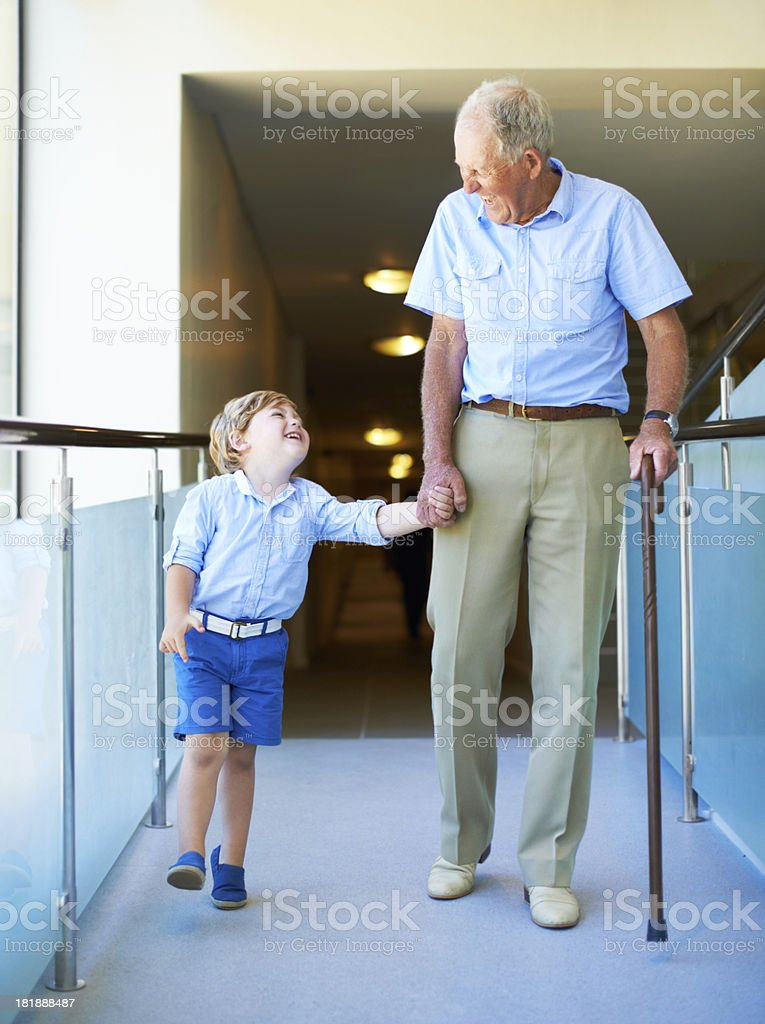 Fun, energetic grandpa playing in waves with young
