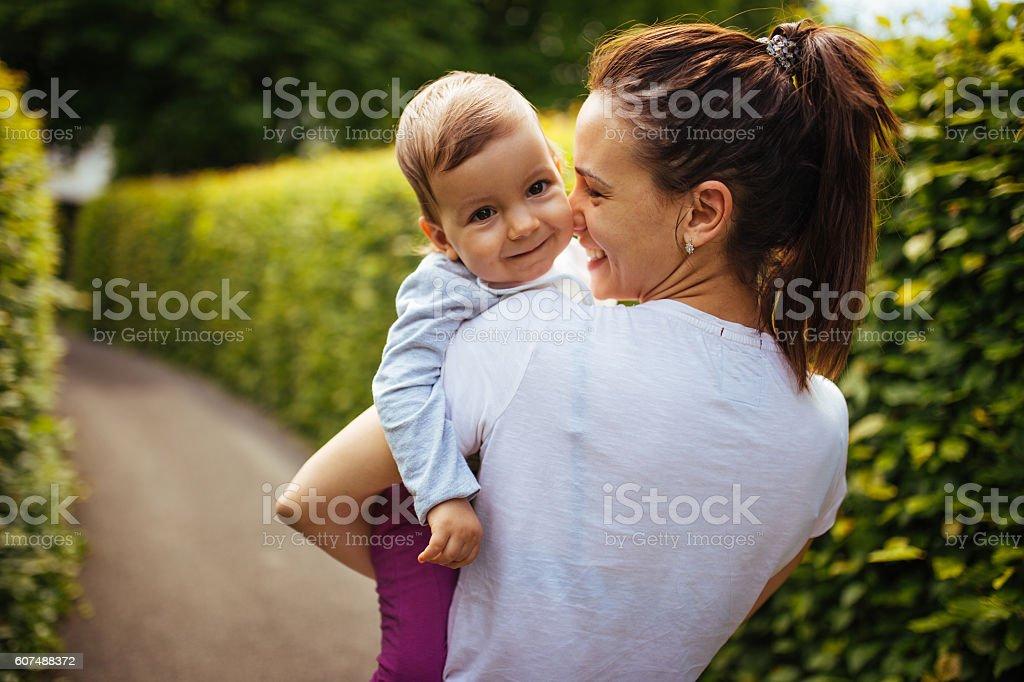 Having fun with mom outdoors stock photo