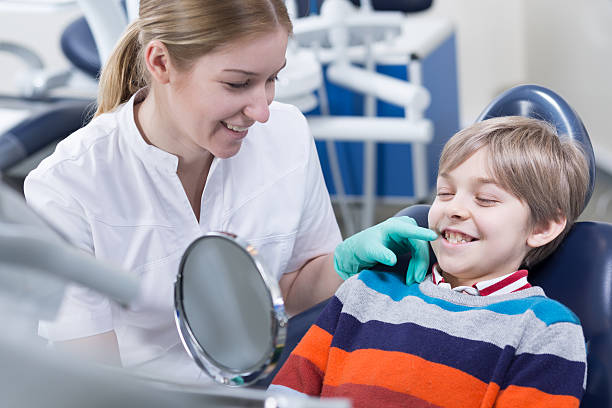 having his monthly orthodontic checkup - dental assistant stock photos and pictures