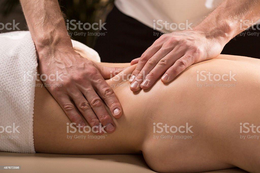 Having lower back massage stock photo