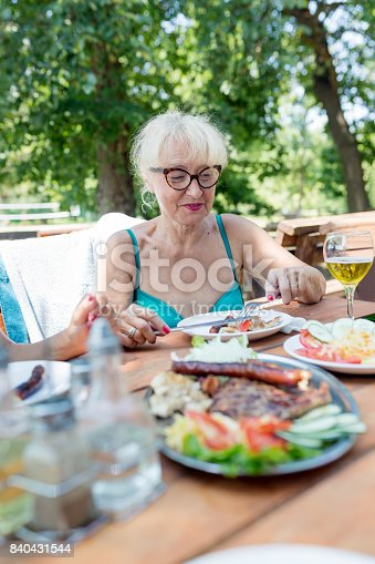 istock Having lunch outdoors 840431544
