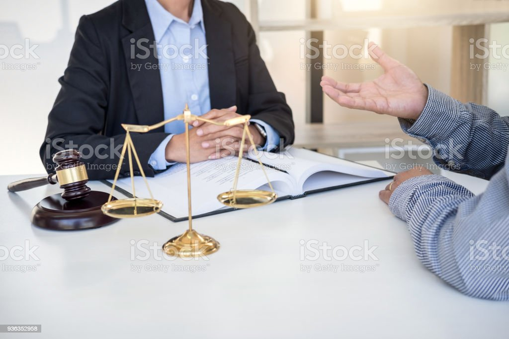 Having meeting with team at law firm, Consultation between a female lawyer and businesswoman customer, tax and contract the company of real estate concept stock photo