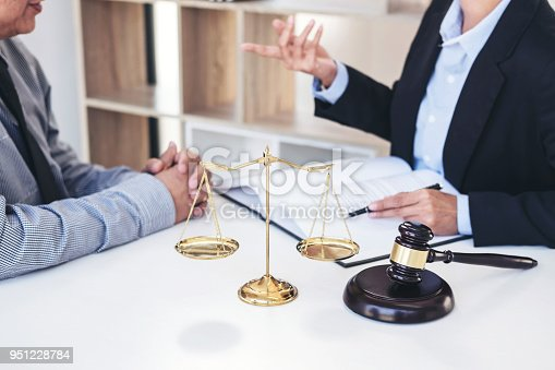 istock Having meeting with team at law firm, Consultation between a female lawyer and businesswoman customer, tax and contract the company of real estate concept 951228784
