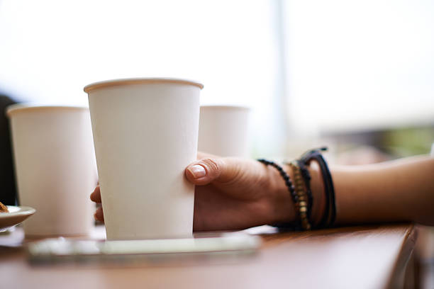 having some coffee - paper coffee cup stock photos and pictures