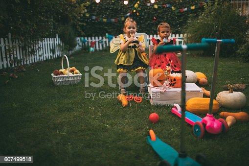 istock Having some Halloween candy 607499518