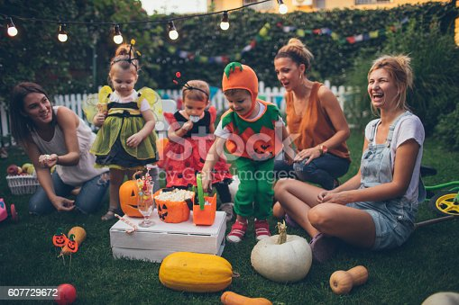 istock Having some Halloween candy 607729672
