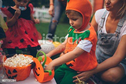 istock Having some Halloween candy 607731284