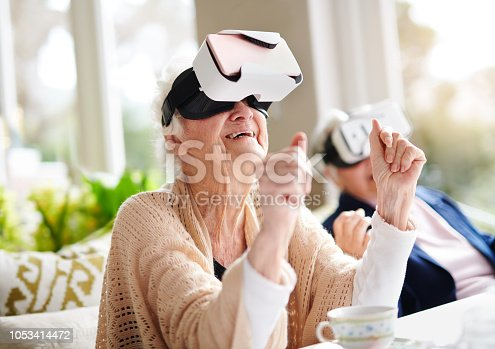 istock Having some virtual fun 1053414472