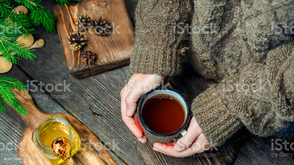 Having tea to get warm in winter stock photo