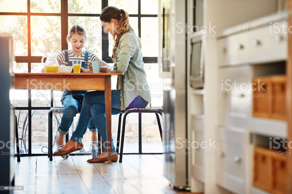 Having the most important meal of the day with mom stock photo