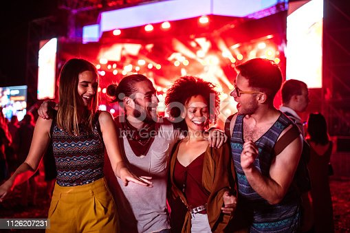 Group of friends dancing at a music festival