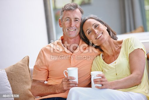 638771390istockphoto Having their morning coffee and dose of laughter 464578308