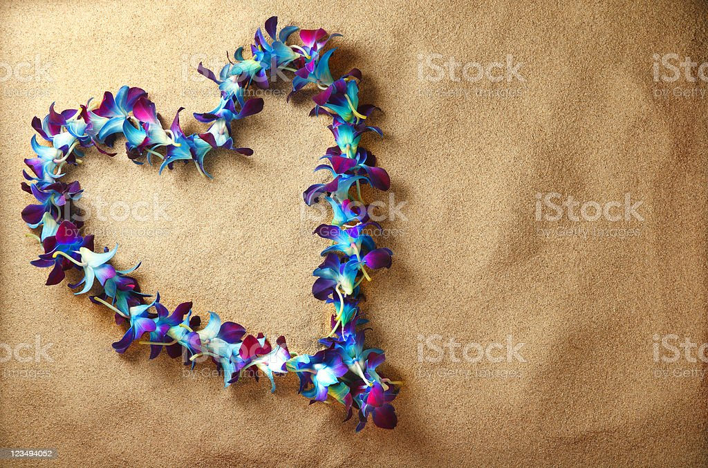 hawaian lei heart on sand royalty-free stock photo