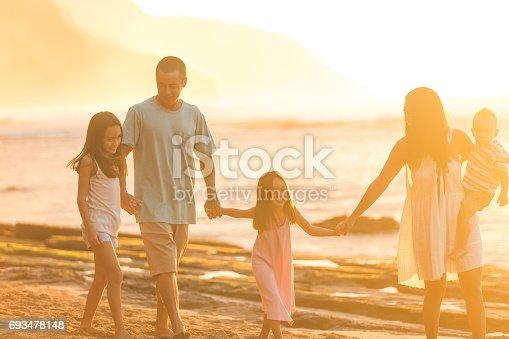 istock Hawaii family vacation on beach 693478148