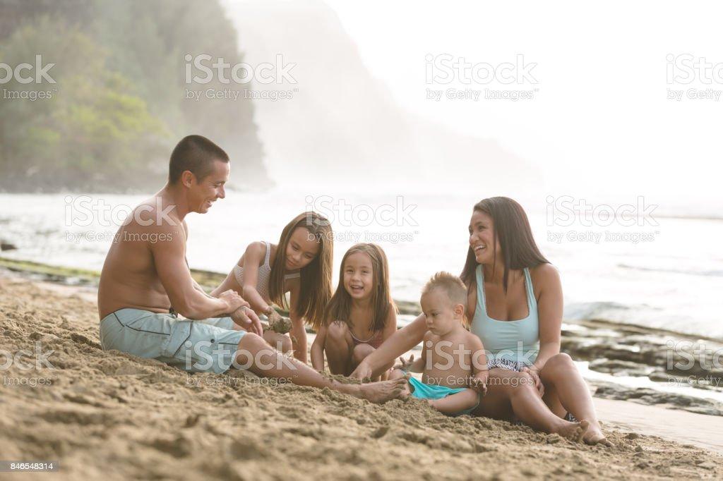 Hawaii family vacation on beach stock photo