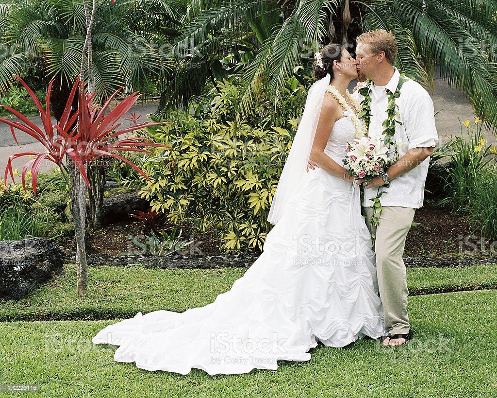 Hawaii wedding bride and groom kiss royalty-free stock photo