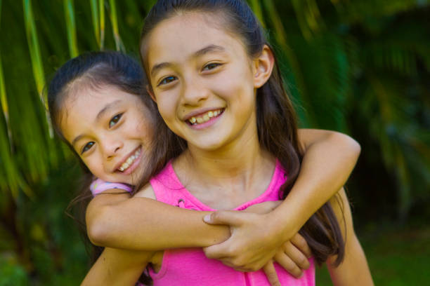 Hawaiian Family Outdoor Portrait with Two Preteen Adolescent Girls stock photo