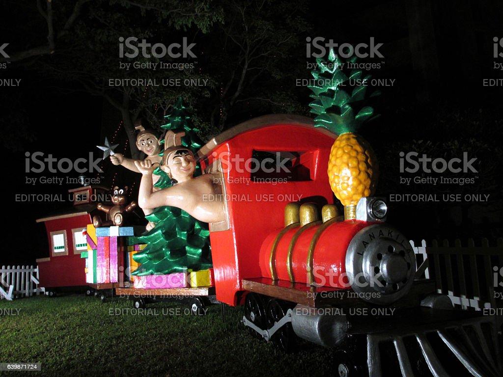 Hawaiian Figures Drive, Shaka, and Ride Christmas stock photo