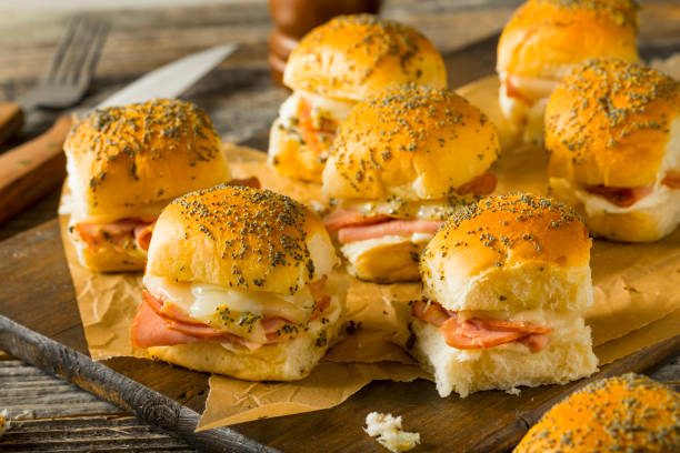 Hawaiian Ham and Cheese Buns Hawaiian Ham and Cheese Buns with Mayo and Poppy Seeds slider burger stock pictures, royalty-free photos & images